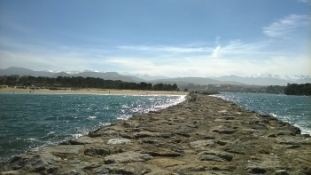 Breakwater at Merón beach, looking to the Picos de Europa